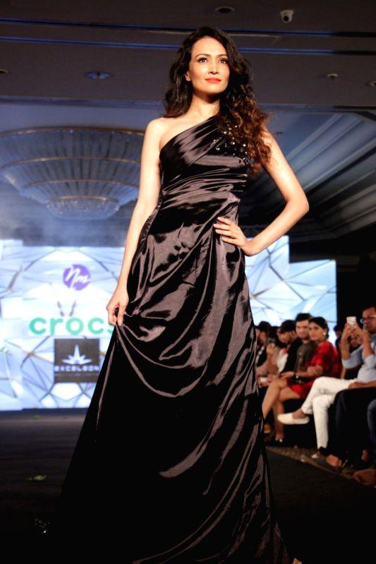 Actress Dipannita Sharma displays the creation of fashion designer Nidhi Munim during the India Intimate Fashion Week in Mumbai on March 18, 2017. - Dipannita Sharma