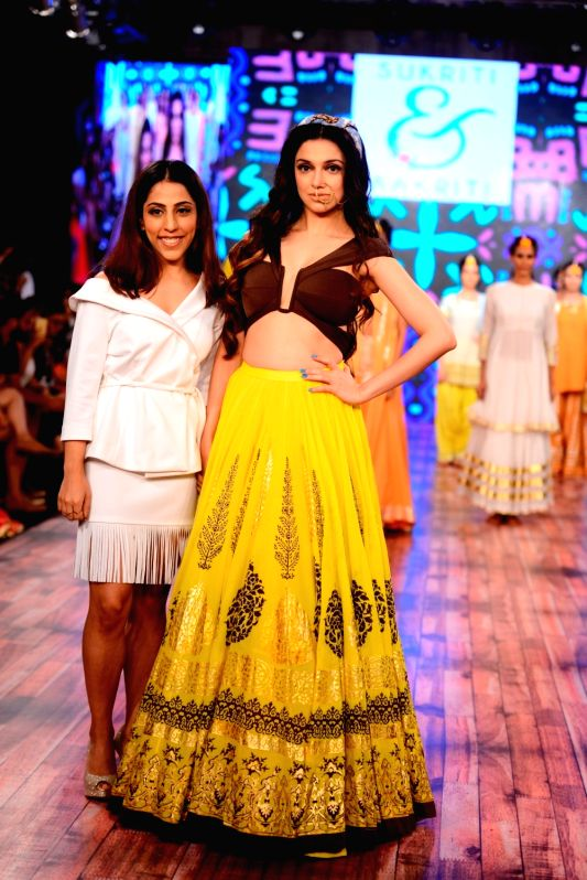 Actress Divya Khosla Kumar showcases creations of fashion designers Sukriti and Aakriti at India Beach Fashion Week (IBFW) 2016 in Panaji on May 22, 2016. - Divya Khosla Kumar