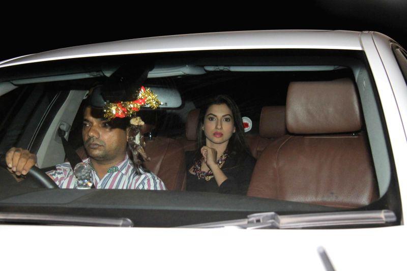 Actress Gauhar Khan arrives at Salman Khan's birthday party in Panvel near Mumbai, India on December 26, 2014. - Gauhar Khan