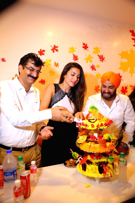 Actress Gauhar Khan inaugrated Kesar`s first ever designer Sweets outlet in New Delhi. - Gauhar Khan