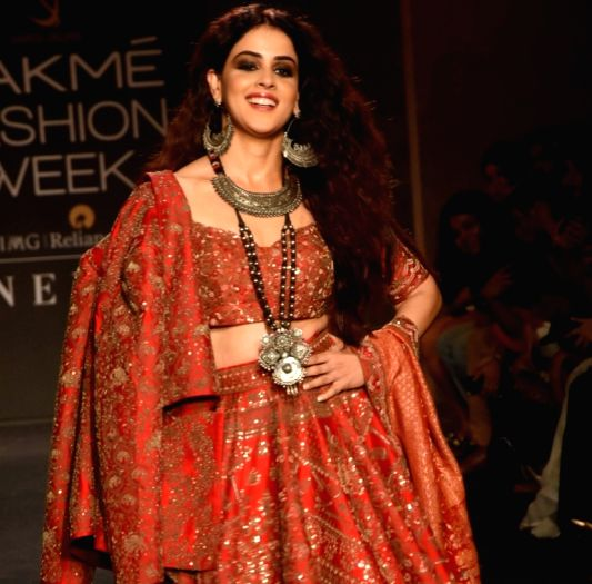 Mumbai: Actress Genelia Deshmukh walks the ramp for designer Saroj Jalan at the Lakme Fashion Week Winter/Festive 2019 in Mumbai on Aug 25, 2019.