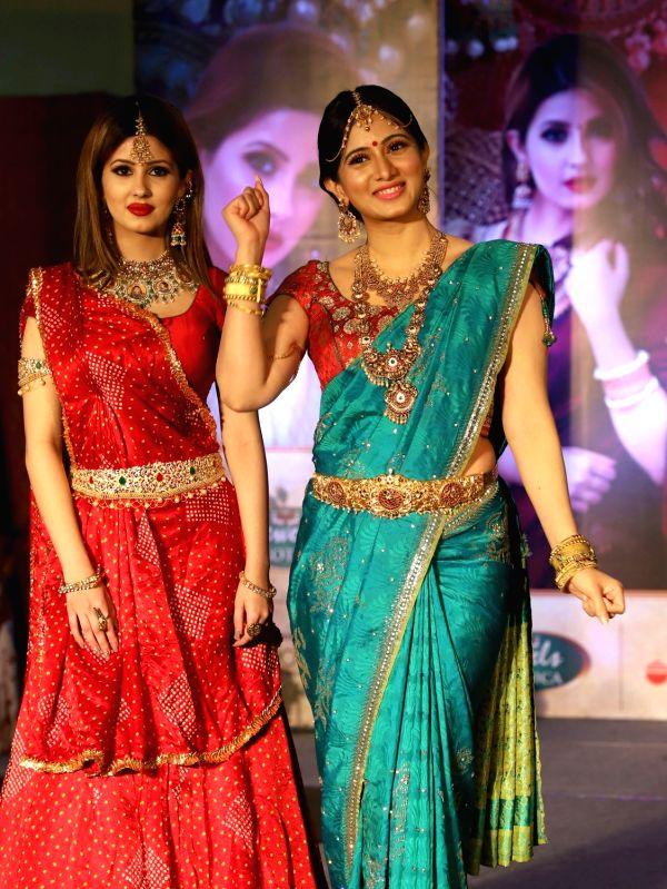 Actress Harshika Poonacha (L) walks the ramp during a jewelry show, in Bengaluru on June 12, 2018. - Harshika Poonacha
