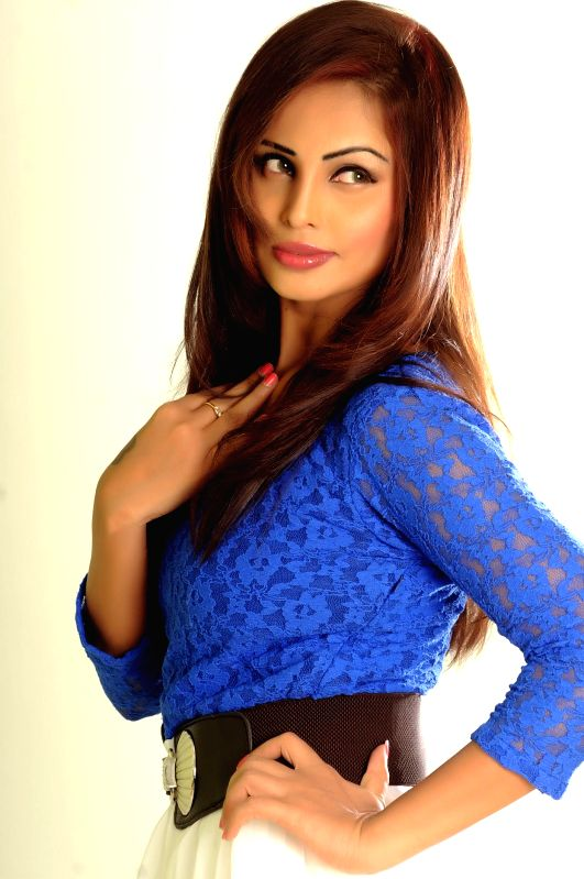 Actress Hasika poses for a photograph during a photoshoot.