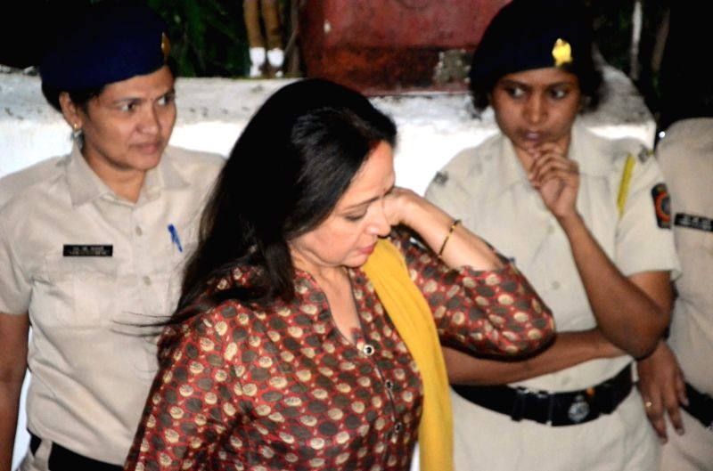 Actress Hema Malini arrives to attend Late actor Shashi Kapoor's condolence meeting in Mumbai on Dec 7, 2017. - Hema Malini and Shashi Kapoor