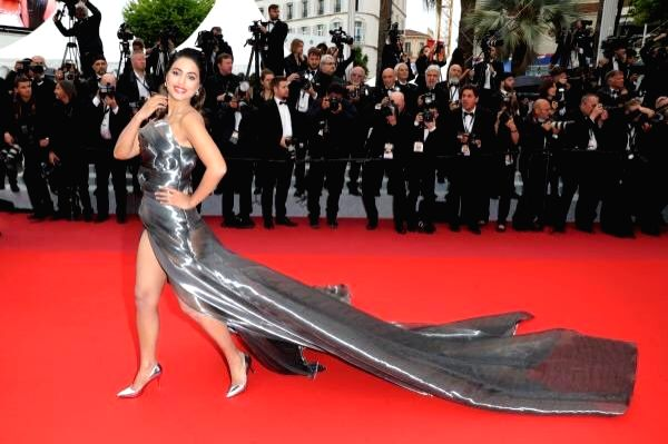 Actress Hina Khan makes an appearance at the red carpet in a metallic grey thigh-high slit sleeveless gown with a long trail on the fifth day of the 72nd Cannes Film Festival in Cannes,