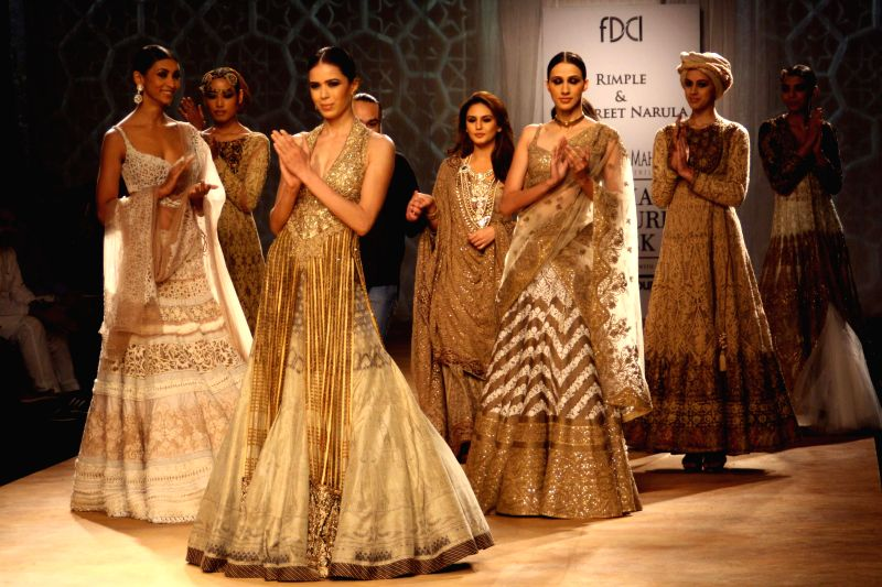 Actress Huma Qureshi walks on the ramp for designers Rimple and Harpreet Narula`s show during the India Couture Week 2014, in New Delhi on July 20, 2014. - Huma Qureshi