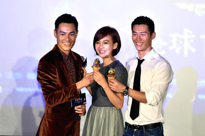 "Actress Ivy Chen (C) and actors Dou Xiao (R) and Tony Yang pose for a group photo during the premiere of the film ""Time to Love"" in Beijing, capital of ... - Ivy Chen and Dou Xiao"