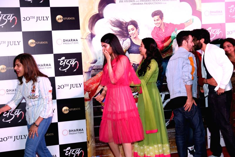 "Actress Janhvi Kapoor with her sister Khushi Kapoor at the trailer launch of her upcoming film ""Dhadak"" in Mumbai on June 11, 2018. - Janhvi Kapoor and Khushi Kapoor"