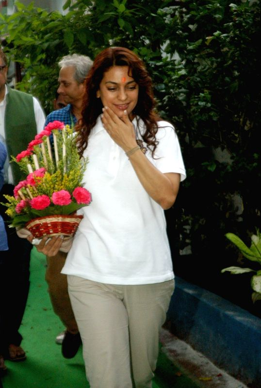 Actress Juhi Chawla arrives at the residence of West Bengal Chief Minister and Trinamool Congress supremo Mamata Banerjee to greet her for her victory in the recently concluded assembly ... - Juhi Chawla and Mamata Banerjee