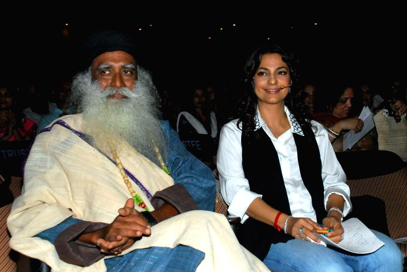 Actress Juhi Chawla with Sadhuguru a yogi and mystic during a function organised for a series of interaction on `In Conversation with the Mystic` in Mumbai on Aug 4, 2014. - Juhi Chawla