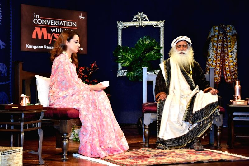 "Actress Kangana Ranaut with Sadhguru Jaggi Vasudev during ""In Conversation with the Mystic"" in Mumbai on Aug 8, 2018. - Kangana Ranaut"