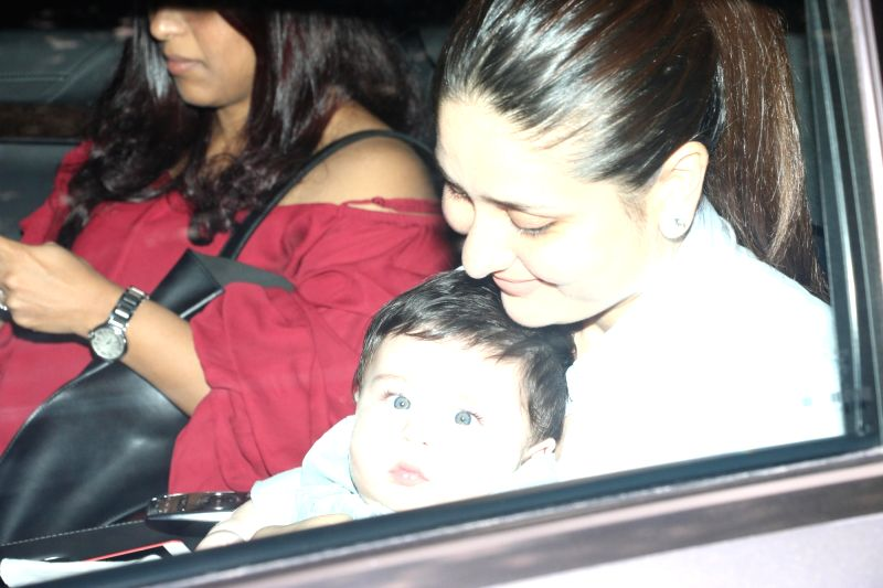 Actress Kareena Kapoor with her son Taimur Ali Khan during Tussar Kapoor son Laksshay`s first birthday party in Mumbai on June 1, 2017. - Kareena Kapoor, Taimur Ali Khan and Tussar Kapoor