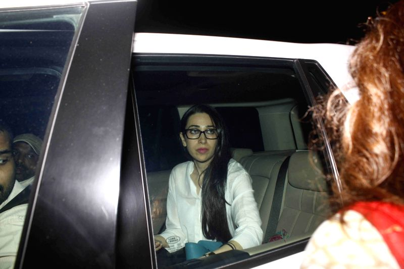 Actress Karisma Kapoor leaves from Bandra Family Court, in Mumbai, on Nov 27, 2015. Karisma Kapoor who had filed for a divorce from her estranged husband Sunjay Kapur, has now decided to ...