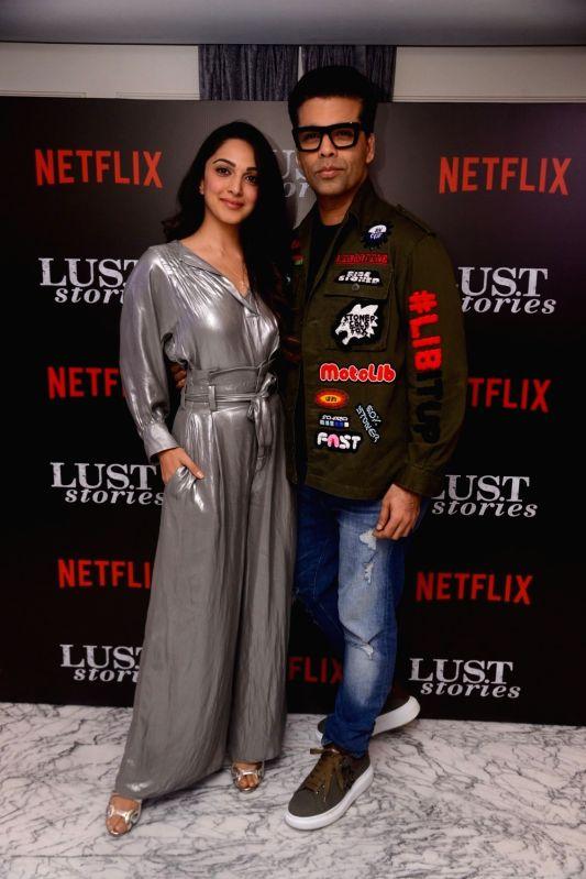 "Actress Kiara Advani and producer Karan Johar at the special screening of Netflix show titled ""Lust Stories"" in Mumbai on June 13, 2018. - Kiara Advani and Karan Johar"