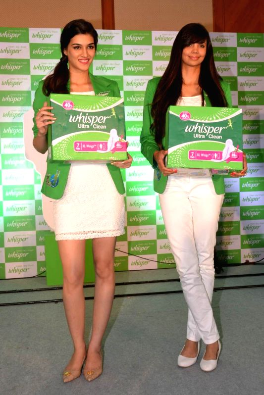 Actress Kriti Sanon and Golf Champion Sharmila Nicollet during a press conference to launch sanitary napkins in Bangalore on Aug 6, 2014.