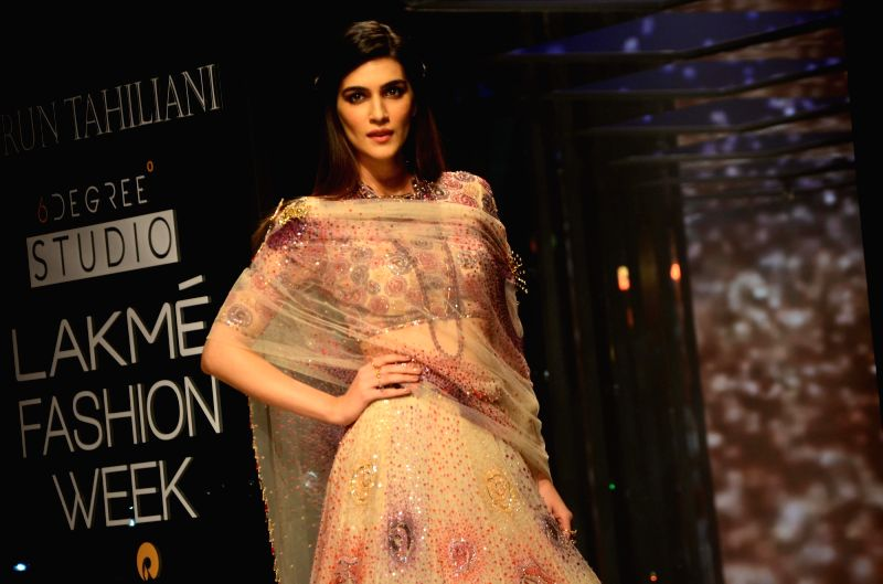 Actress Kriti Sanon walk the ramp for fashion designer Tarun Tahiliani during the Lakme Fashion Week Summer/Resort 2018 in Mumbai on Feb 2, 2018. - Kriti Sanon