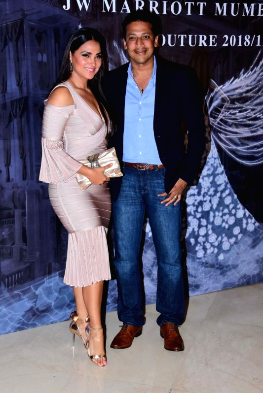 Actress Lara Dutta along with her husband Mahesh Bhupathi at the fashion designer Manish Malhotra's Haute Couture 2018 in Mumbai. - Lara Dutta, Mahesh Bhupathi and Manish Malhotra
