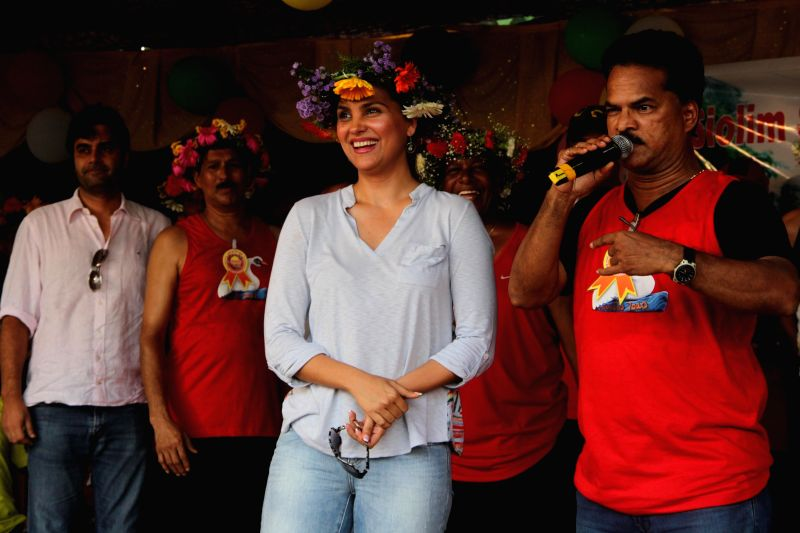Actress Lara Dutta witnesses a programme organised on the occasion of 'Sao Joao' at Siolim, 25 km away from Panaji on June 24, 2014. - Lara Dutta