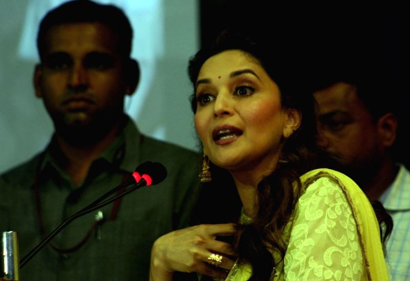 Actress Madhuri Dixit addresses during `Mamta Abhiyan`- a campaign related to mother and girl child in Bhopal on June 26, 2014.