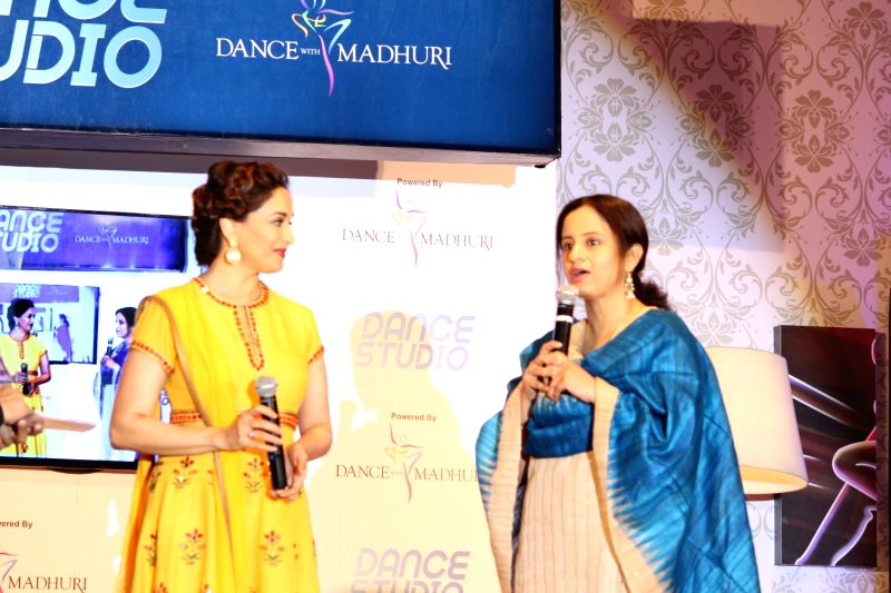 Actress Madhuri Dixit  and Pallavi Puri, Chief Commercial Officer, Tata Sky during the launch of Tata Sky's new interactive service 'Dance Studio' in association with RnM Moving Picture in ... - Madhuri Dixit