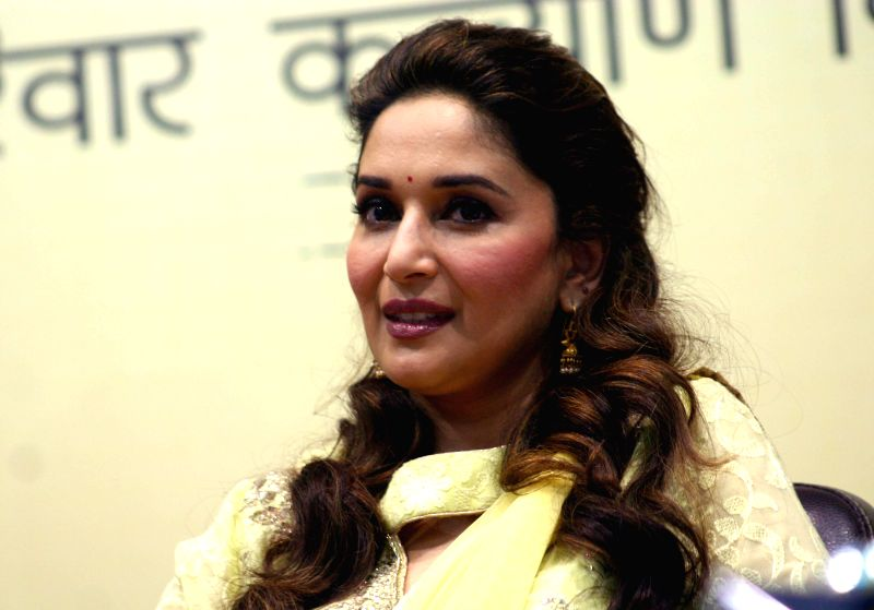 Actress Madhuri Dixit during `Mamta Abhiyan`- a campaign related to mother and girl child in Bhopal on June 26, 2014.