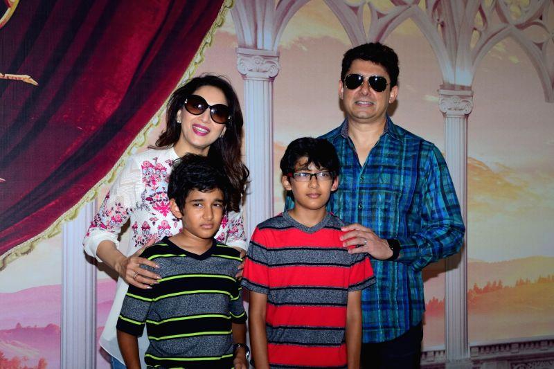 Actress Madhuri Dixit Nene along with her husband Sriram Nene and sons Raayan Nene and Arin Nene during Disney India's Beauty and the Beast musical event, in Mumbai, on May 8, 2016. - Madhuri Dixit Nene