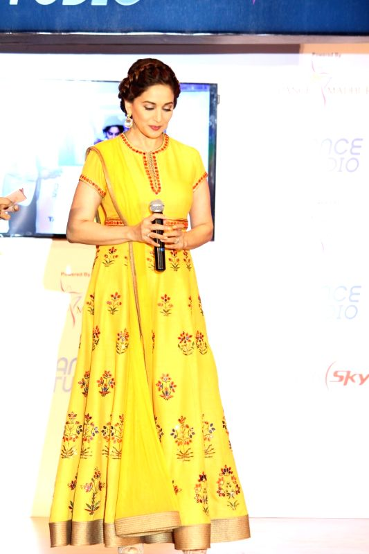 Actress Madhuri Dixit Nene during the launch of Tata Sky's new interactive service 'Dance Studio' in association with RnM Moving Picture in Mumbai on  Dec 10,  2015 - Madhuri Dixit Nene