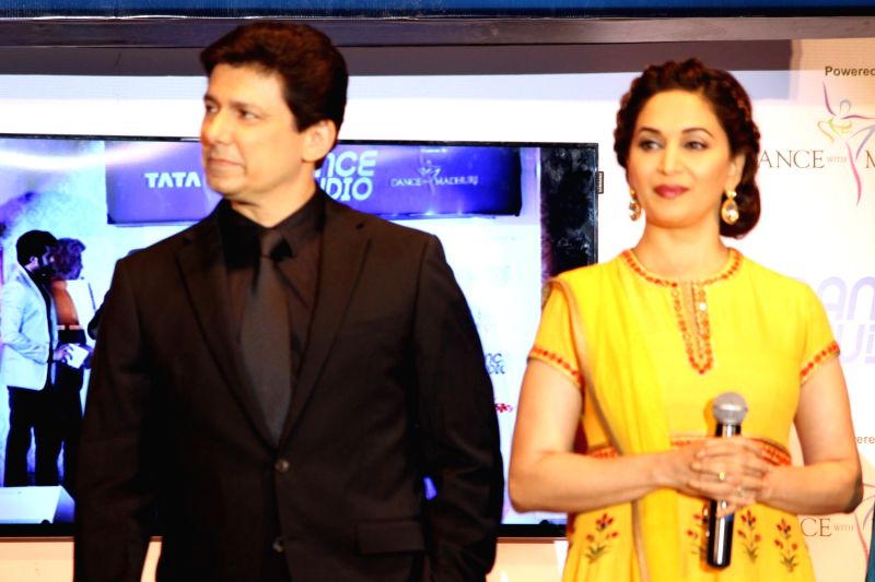 Actress Madhuri Dixit Nene with her husband Shriram Nene  during the launch of Tata Sky's new interactive service 'Dance Studio' in association with RnM Moving Picture in Mumbai on  Dec 10,  ... - Madhuri Dixit Nene