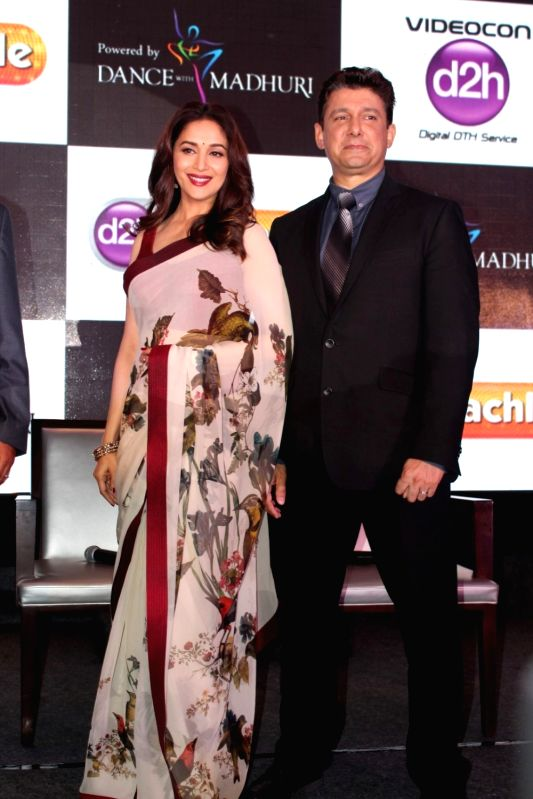 Actress Madhuri Dixit Nene with her husband Dr. Shriram Nene during launch of d2h Nachle, an interactive dance service by Videocon d2h in Mumbai on May 10, 2017. - Madhuri Dixit Nene