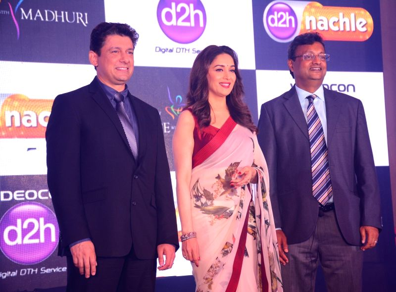 Actress Madhuri Dixit with Dr. Shriram Nene and Videocon d2h Head Marketing Sugato Banerji at the launch of new value added service of Videocon d2h on May 10, 2017. - Madhuri Dixit