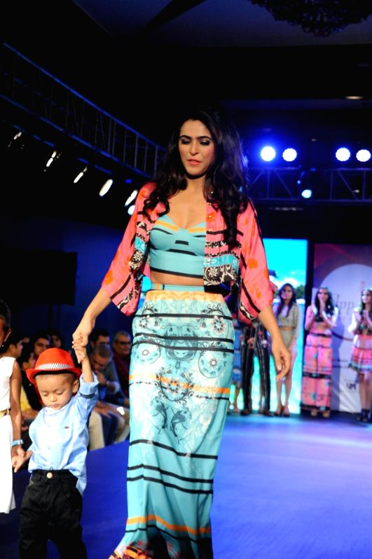 Actress Madhurima Tuli participate walk for Applause for Cause, a fund raising fashion show for an NGO called Access Life that caters to cancer treatments for children in Mumbai, on Nov 29, ... - Madhurima Tuli