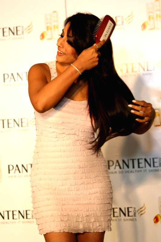 Actress Mahi Gill take extraordinary ``Live Hair Dares`` with Pantene`s new improved range, in New Delhi on June 17,2014.