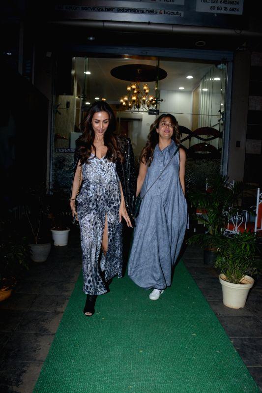 Actress Malaika and Amrita Arora spotted at Muah Salon in Bandra in Mumbai on Feb 9, 2019. - Malaika and Amrita Arora