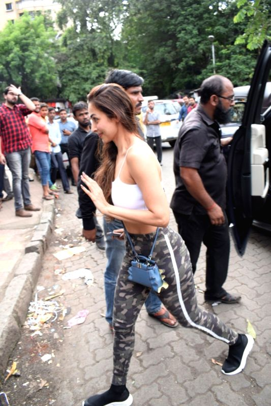 Actress Malaika Arora arrives to attend a programme organised to celebrate Friendship Day in Mumbai's Bandra on Aug 5, 2018. - Malaika Arora