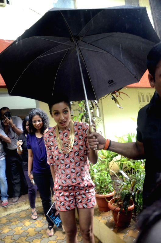 Actress Malaika Arora Khan arrives to launch `Savy` - a magazine in Mumbai on July 7, 2014.