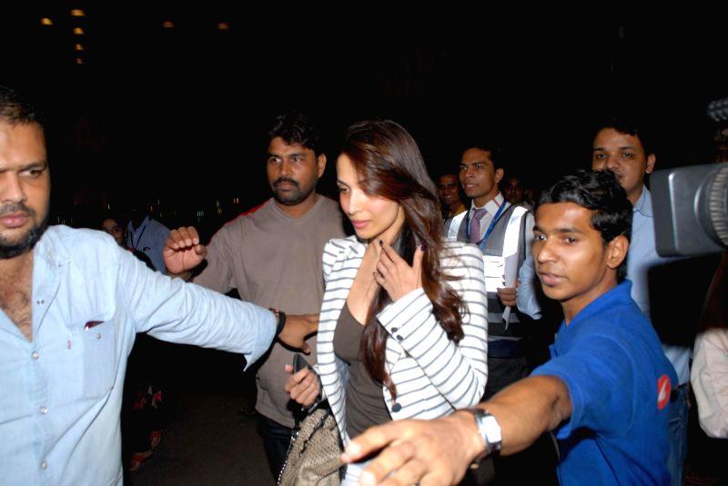 Actress Malaika Arora Khan at the Terminal 2 of the Chhatrapati Shivaji International Airport leaving for International Indian Film Academy (IIFA) Awards in Mumbai on 22nd April 2014. - Malaika Arora Khan