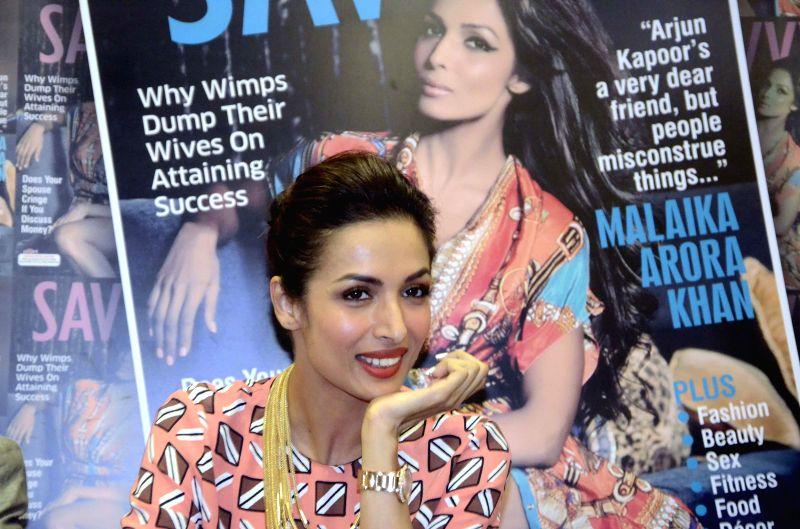 Actress Malaika Arora Khan during launch of `Savy` - a magazine in Mumbai on July 7, 2014.