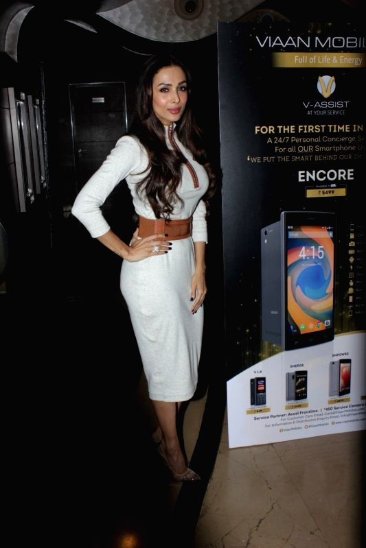 Actress Malaika Arora Khan during the launch of Viaan Mobile phones named after Shilpa Shetty and Raj Kundra son`s name in Mumbai on November 25, 2015. - Malaika Arora Khan, Shilpa Shetty and Raj Kundra