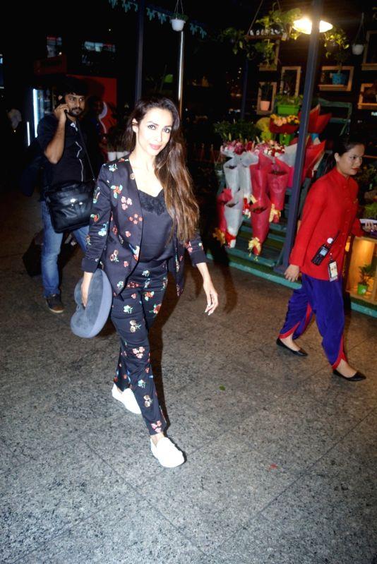 Actress Malaika Arora Khan seen at Chhatrapati Shivaji International Airport in Mumbai on July 11, 2018. - Malaika Arora Khan