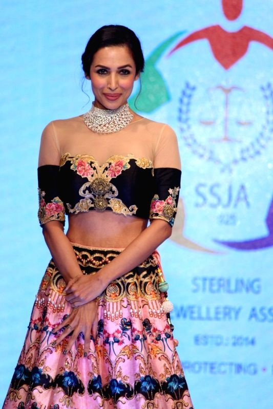 Actress Malaika Arora walks the ramp for designer Archana Kochhar during the Ssja Silver Nite Fashion Show, in Mumbai, on August 6, 2016. - Malaika Arora