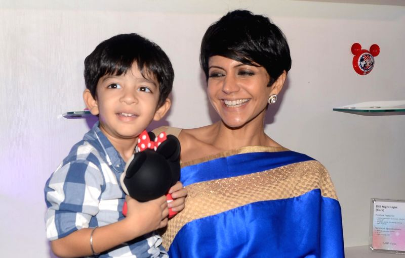 Actress Mandira Bedi and her son during the launch of Philips- Disney lighting range for kids in New Delhi on July 23, 2014. - Mandira Bedi