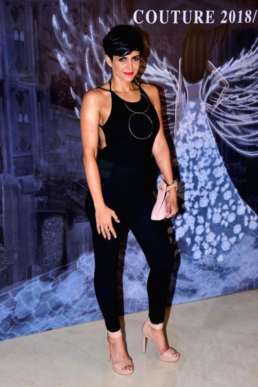 Actress Mandira Bedi at the fashion designer Manish Malhotra's Haute Couture 2018 in Mumbai. - Mandira Bedi and Manish Malhotra