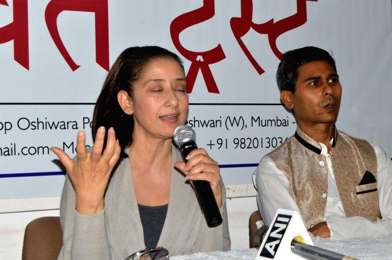 Actress Manisha Koirala and Yoga Guru Shambhu Sharan Jha during a press conference in Mumbai on March 25, 2017. - Manisha Koirala