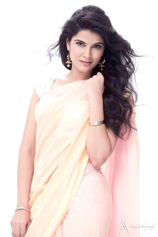 Actress Manisha Shree poses  for a photograph during a photoshoot.
