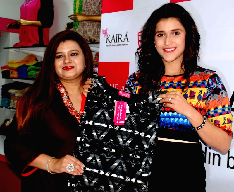 Actress Mannara Chopra and KAIRA director Karishma Manglani during the launch of Designer Festive Collection and Celebrations of KAIRA 60 Stores in Hyderabad on July 27, 2016. - Mannara Chopra