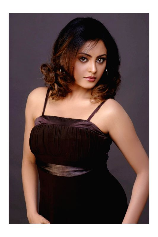Actress Meenakshi poses for a photo during a photoshoot.