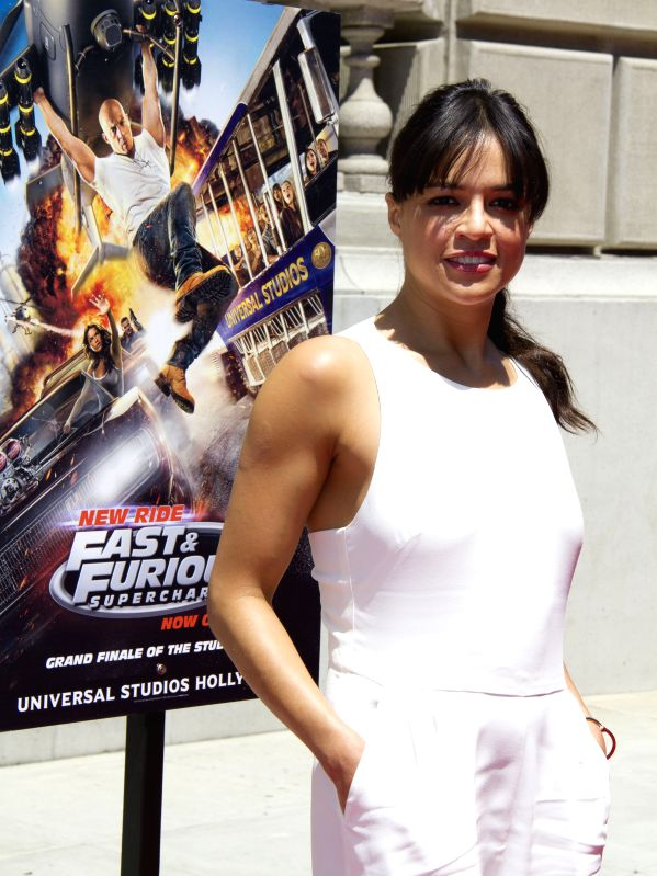 """:Actress Michelle Rodriguez attends the premiere of Universal Studios Hollywood's thrill ride,""""fast & FuriousSupercharged"""", in Universal City of ..."""