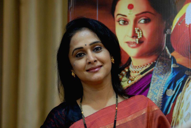 Actress Mrinal Kulkarni during a press conference to promote upcoming Marathi film `Rama Madhav` in Pune on July 28, 2014. - Mrinal Kulkarni