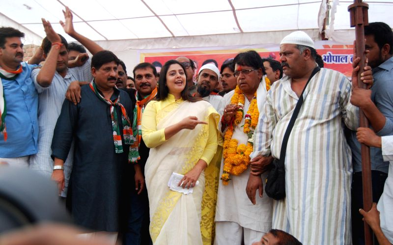 Actress Nagma campaigns for Congress candidate from Bhopal P C Sharma in Bhopal on April 15, 2014.