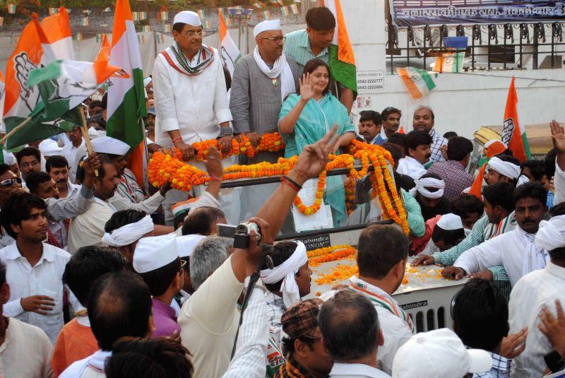 Actress Nagma campaigns for party's candidate from Varanasi Lok Sabha seat, Ajay Rai in Varanasi on May 5, 2014.